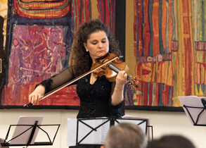 Hungarian violinist, Orsolya Korcsolan, performing in the VIC during commemorative ceremony on Holocaust Remembrance Day